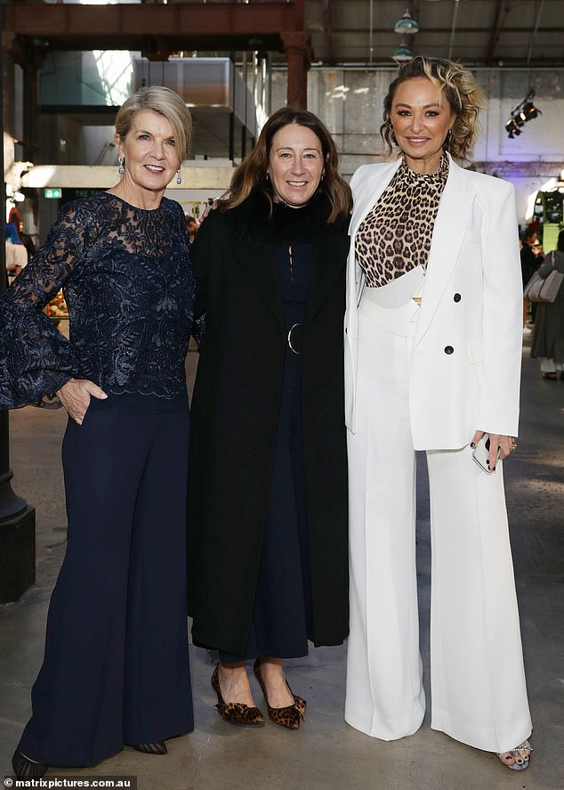 Fashionable friends: The former politician posed for a photo alongside Vogue Australia Editor Edwina McCann (centre), dressed in a sleek all-black outfit, and fashion designer Camilla Franks (right) in a white suit with a fierce animal print top