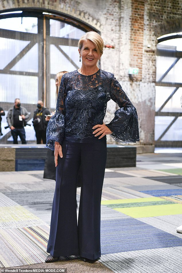 The Minister for fashion is in! Julie Bishop looked chic in an embellished lace top with bell sleeves and matching flare trousers