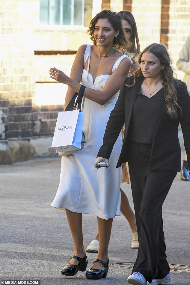 Cheerful:Vanessa, who is believed to be single following her split from the High School Musical star, appeared to be in a good mood as she chatted to friends