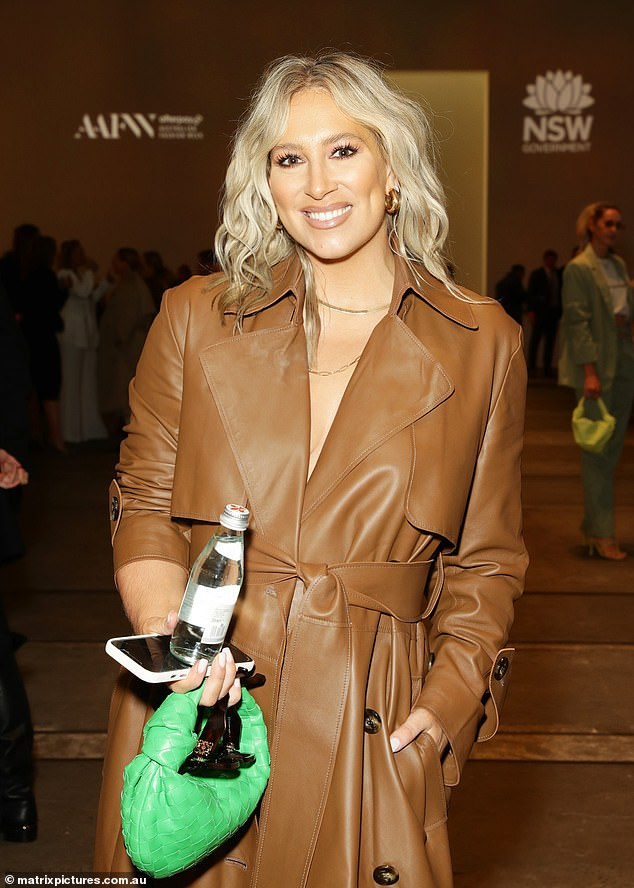 Green with envy: The ex of former NRL star Sam Burgess added a pop of colour to the ensemble with bright green mesh shoes and a matching handbag