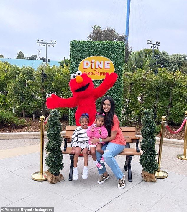 First pic:The barrage of posts started on Sunday evening with a snap of the mother and her young daughters next to a Dine With Elmo And Friends sign