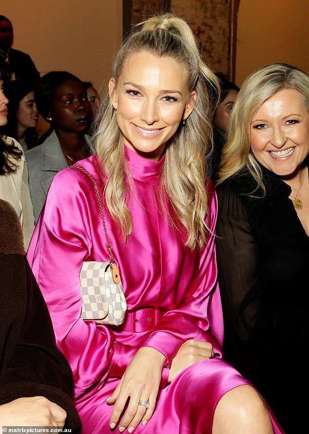 Think pink!The Bachelor's Anna Heinrich was spotted sitting front row at a fashion show wearing a neon pink dress with long sleeves