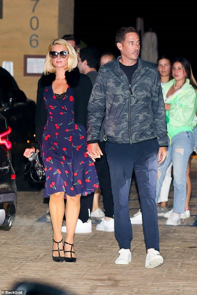 Loved up: Paris Hilton, 40, was spotted grabbing a bite to eat at Nobu in Los Angeles with her fiancé Carter Reum on Sunday