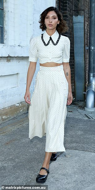 Details: Vanessa's white midriff top featured a polka dot print and a Peter Pan collar