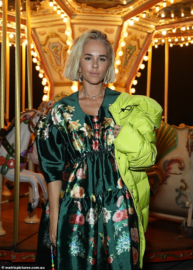 All hers:The P.E Nation co-founder, 41, added open-toe heels, and was her label's own best advertisement, draping a P.E Nation neon yellow puffer jacket over her shoulder