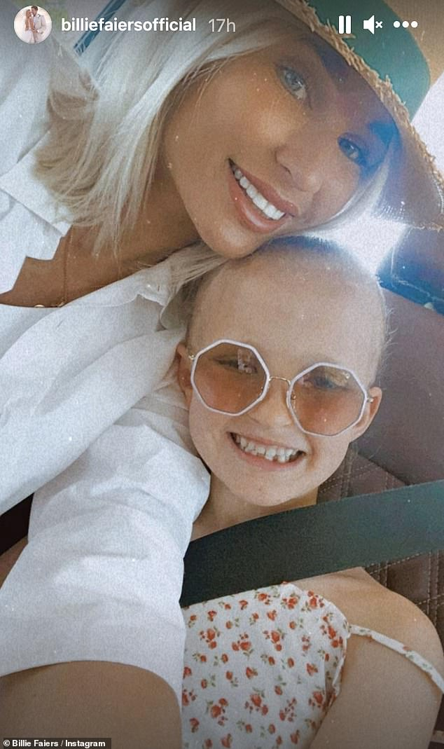 Happy days:The Mummy Diaries star looked effortlessly glamorous as she smiled for a photograph with daughter Nelly