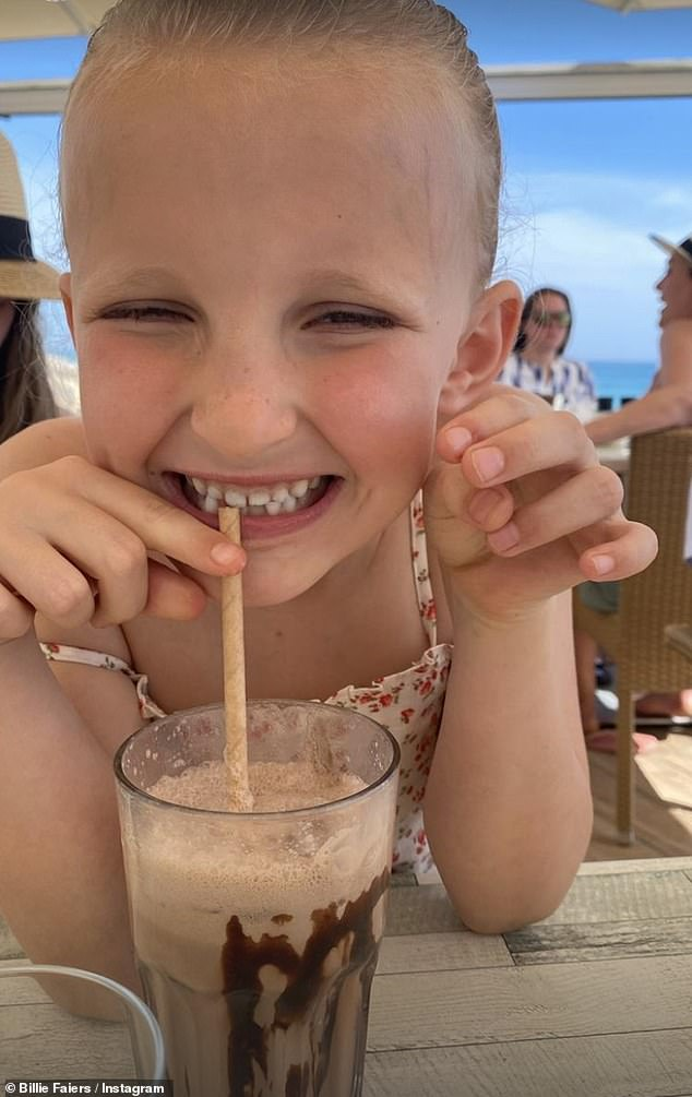 Sweet treats: Nelly couldn't hide her delight as she indulged in a chocolate milkshake