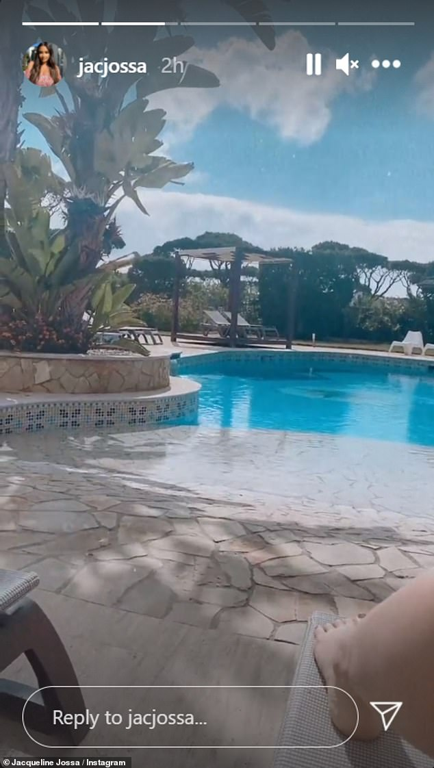 Sunny:Jacqueline was surrounded by palm trees in the mysterious location where she did not appear to be joined by husband Dan Osborne