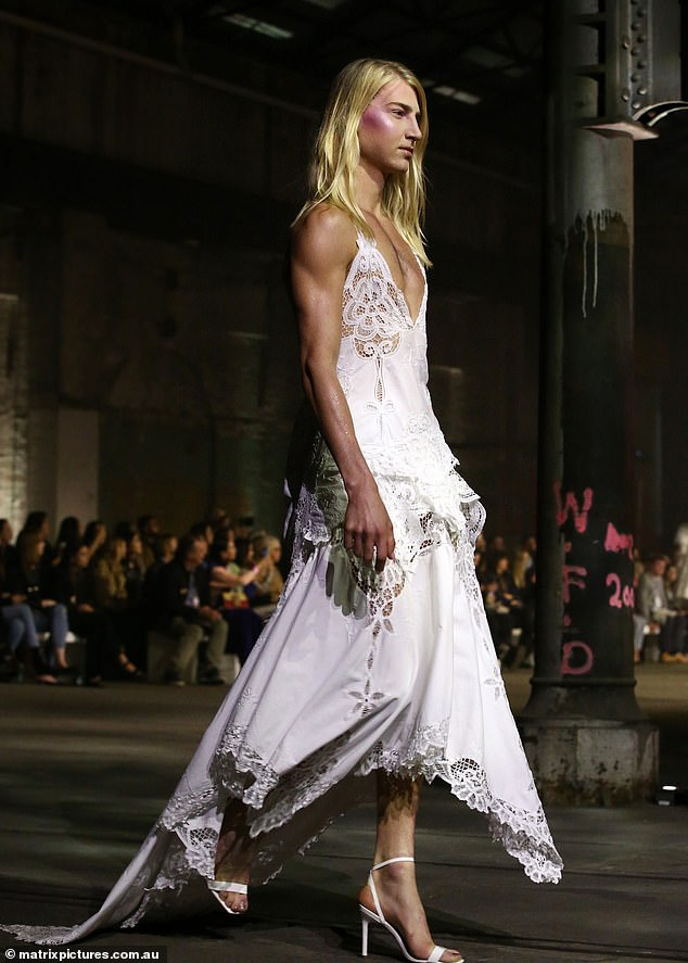 Makes it look easy: Christian effortlessly strutted across the catwalk in towering while stilettos