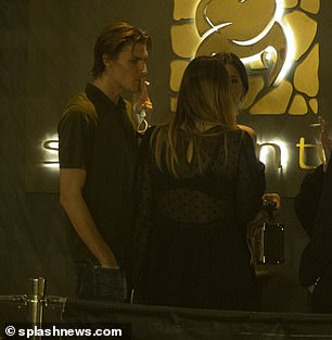 Evening out: After finishing his cigarette and chatting to the two women, Jack headed back inside