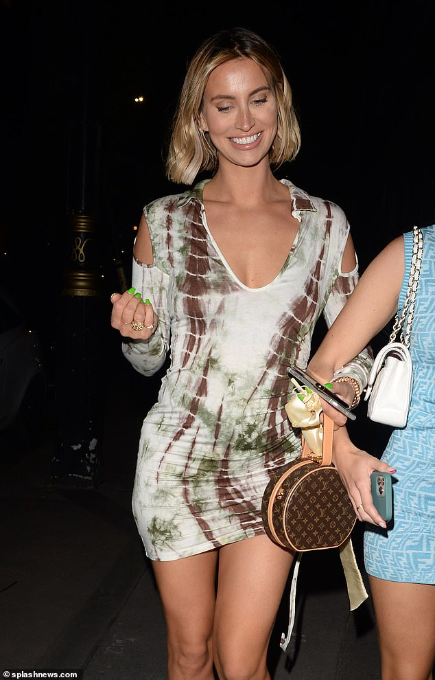 Stunning: Ferne McCann ensured to flaunt her sensational figure in a funky skin-tight dress as she enjoyed a night out in London on Sunday
