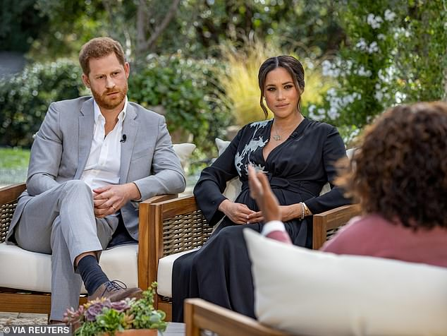 After Meghan Markle accused Kate Middleton of making her cry during the bombshell Oprah Winfrey interview in March (pictured, with Prince Harry), the duchess decided to 'rise above' it and act as a peacemaker, royal expert Camilla Tominey claimed
