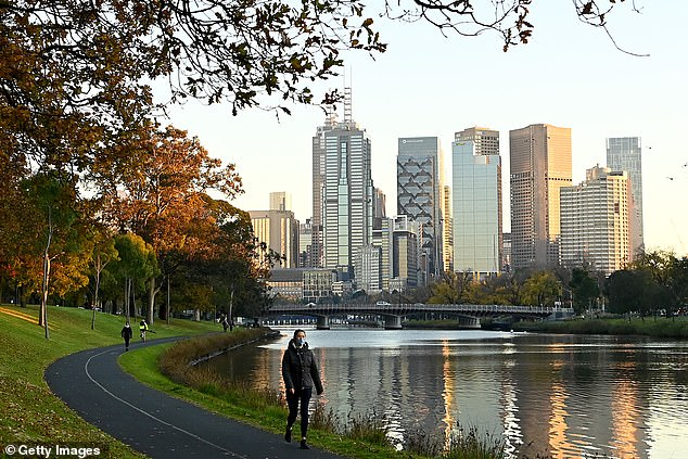A woman exercises alongside Melbourne's Yarra River on Monday as residents remain in lockdown