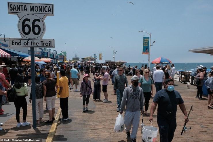Santa Monica, California: Crowds walked down the boardwalk on Monday to enjoy their day off