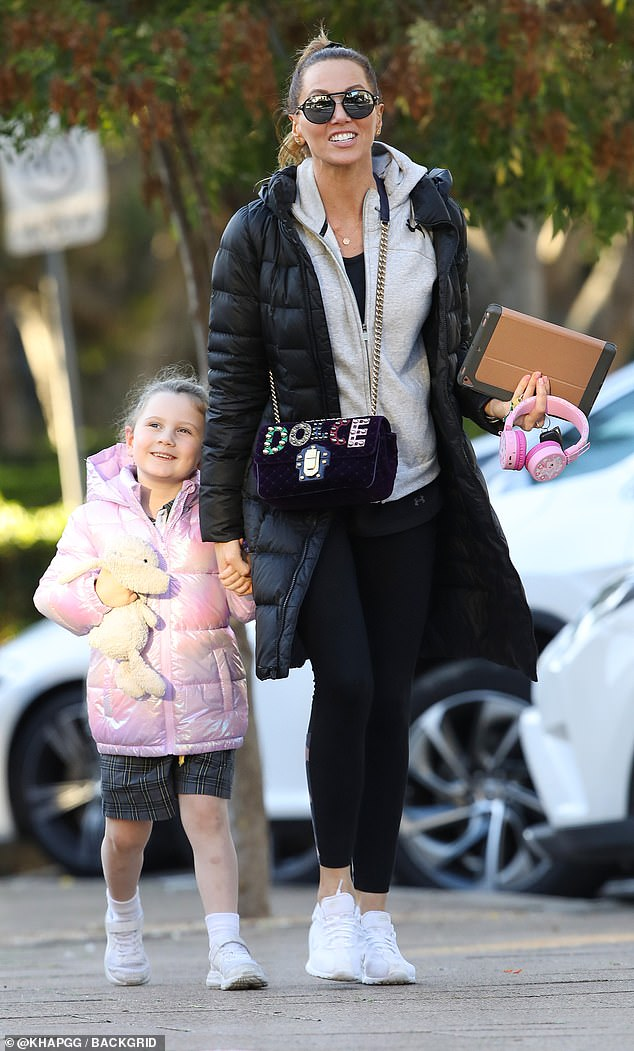 Winning! Cricket WAG Kyly Clarke couldn't stop smiling on Monday as she stepped out for the first time since her romantic getaway with ex-husband Michael over the weekend. Pictured in Sydney with her five-year-old daughter, Kelsey Lee