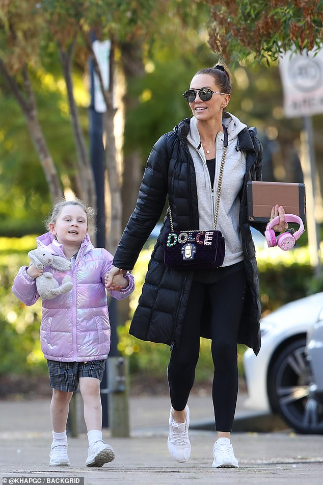 Spring in her step! The39-year-old flashed a triumphant smile as she strolled down the street while holding hands with Kelsey Lee