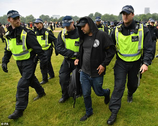 Police detain a man during a Black Lives Matter protest rally in Hyde Park, London, on June 12 last year