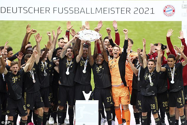 Bayern lift the Bundesliga trophy after winning their ninth consecutive league championship