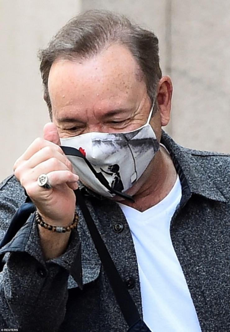 During his outing on Tuesday, Spacey wore a face mask showing Banksy's Girl With Balloon mural