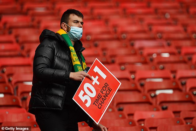 They also held placards with the '50+1' slogan during their club's match against Fulham