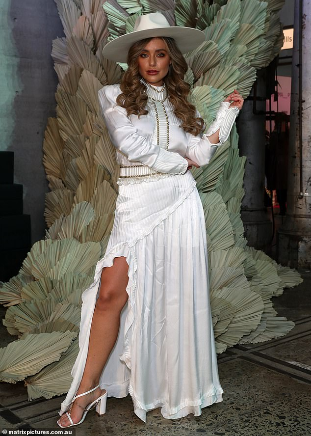 Yee-haw!The reality diva worked all her best angles in a fitted shirt with elongated cuffs and ruched detailing.She paired the top with a floor-length maxi skirt framed by pleated frills