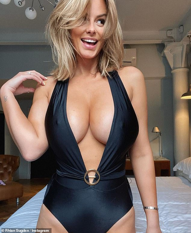 'Can you tell I'm excited about getting my bikinis out?' Rhian Sugden put on a busty display as she posed in a plunging swimsuit in sizzling snap she shared on Instagram on Tuesday