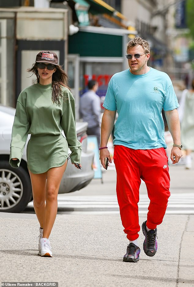 Take five!Emily Ratajkowski enjoyed some well-deserved time parents-only time as she stepped out in New York City with her husband Sebastian Bear-McClard on Tuesday