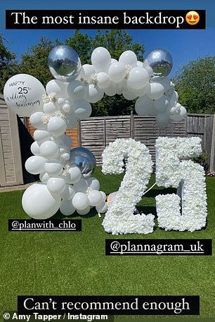 25 years: On the family lawn, a white balloon arch had been erect and a large '25' had been created out of crisp white flowers