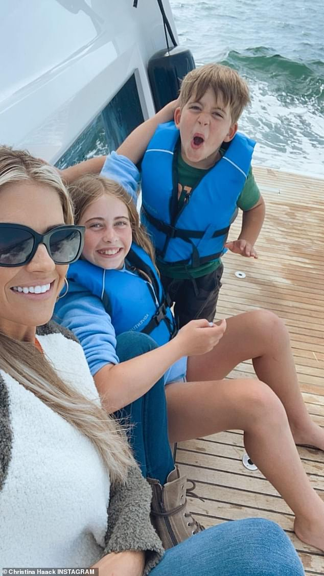 The little ones: And in this image she is with Taylor and Brayden on a boat