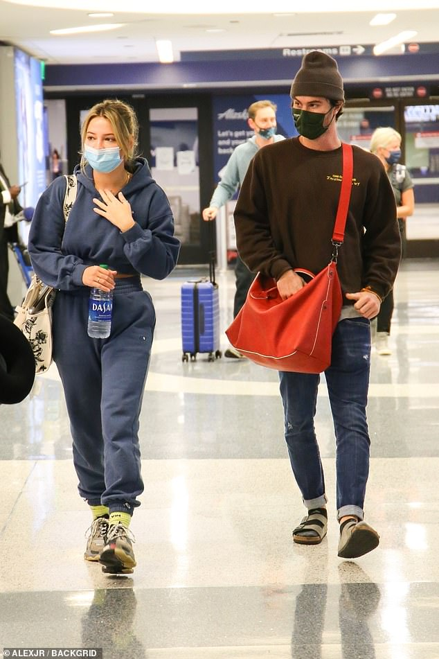 Touching down: Madelyn Cline and Chase Stokesarrived together at LAX Airport on Sunday night after a Memorial Day weekend trip to The Hamptons in New York
