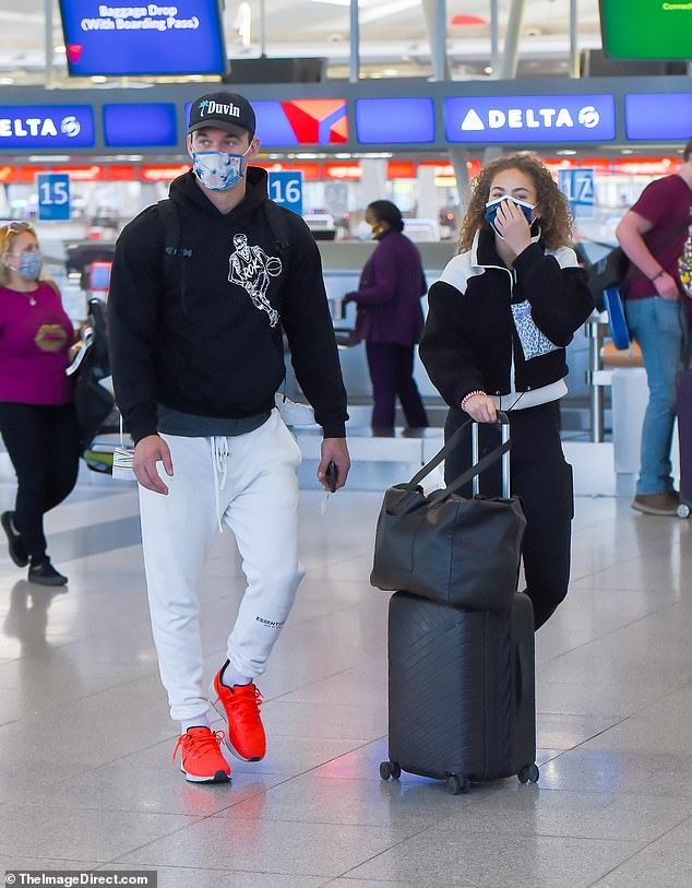 Don't sweat it!The reality star wore a black hoodie with a basketball player design, white sweats and a tie-dye face mask covering his hunky face
