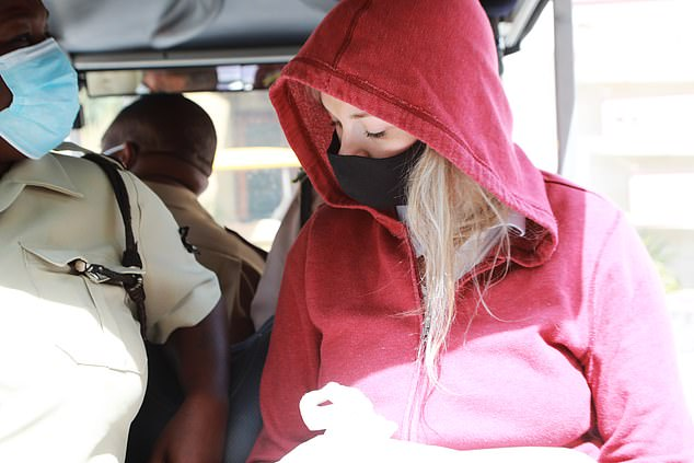 Hartin was seenclutching only a plastic bag that mostly obscured her handcuffs.She was put on the back of a golf cart which was driven to a secluded port five minutes from the station before she was placed on a boat bound for the mainland