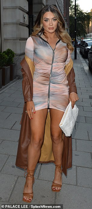 Chic!While her sister Frankie, 26, looked chic in a pink figure-hugging mini dress and brown leather-look trench coat