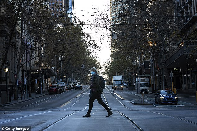 Testing numbers continue to be high, with 51,033 in the last 24 hours as Victoria battles to contain the outbreak (pictured, a Melburnian on a quiet Swanston Street on Wednesday)