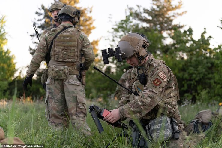 U.S. Air Force Senior Airman Sean Gilliland, 435th Contingency Response Squadron radio frequency transmissions systems technician, right, establishes communications during exercise Swift Response 21 at Cheshnegirovo Airfield, Bulgaria, May 11, 2021