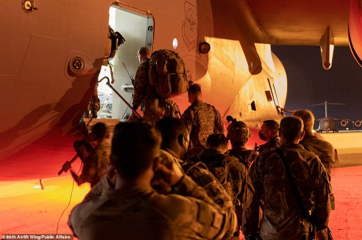 U.S. Air Force Airmen assigned to the 435th Contingency Response Group and U.S. Army Soldiers assigned to the 173rd Infantry Brigade board a C-17 Globemaster III aircraft for joint forcible entry into Cheshnegirovo Airfield, Bulgaria, during exercise Swift Response 21 at an air base in Hungary