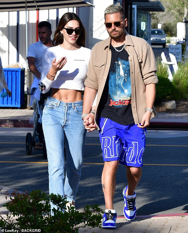 Heating up: Though sources have said that the pair's relationship is 'serious,' many continue to think Scott is just trying to get over Kourtney with another younger model; pictured May 2021