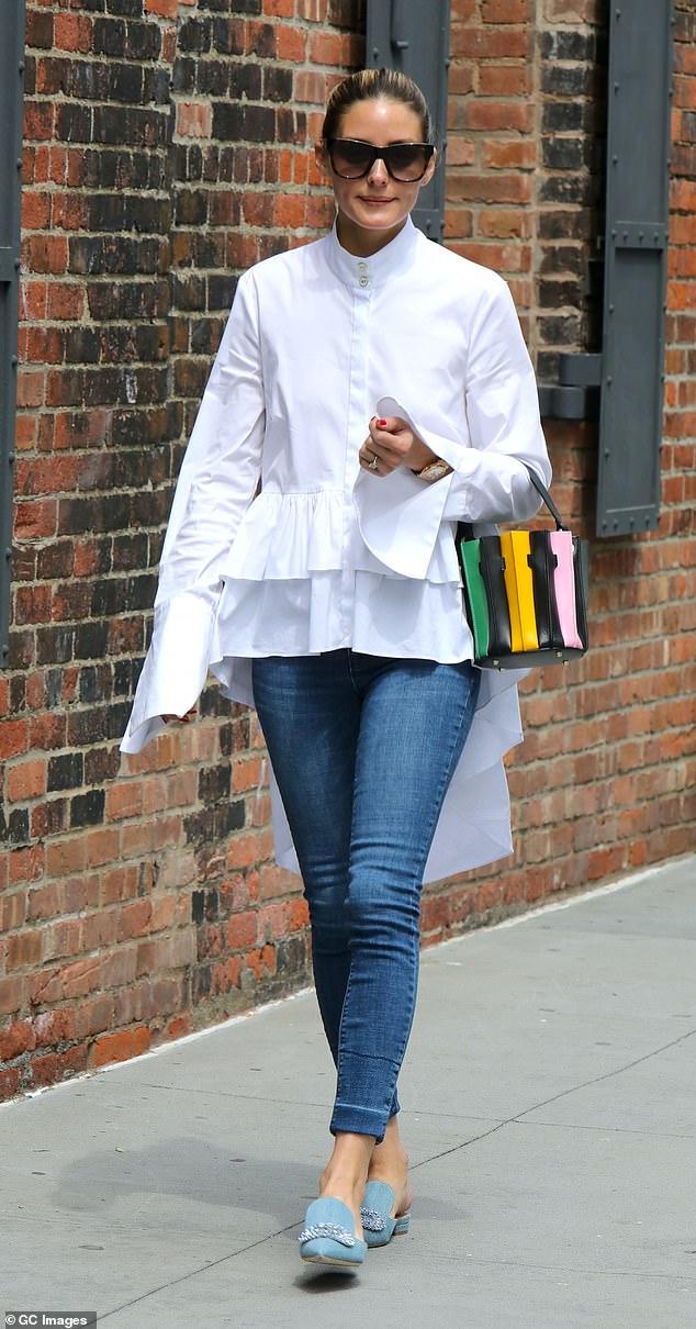 Fashionista: Former reality star and influencer Olivia Palermo, 35, stepped out in NYC Tuesday in an eclectic ensemble of double ruffled white blouse and skinny blue jeans