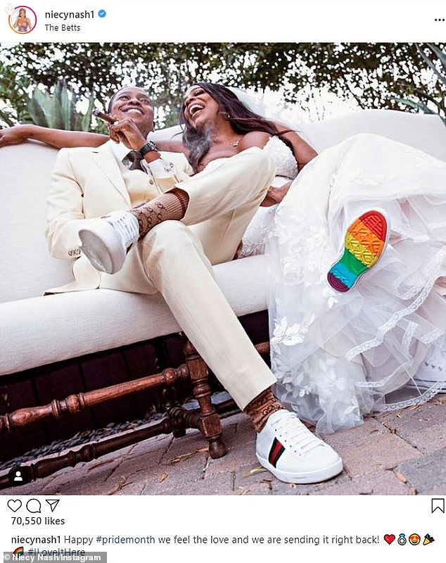 Celebrating: She married singer Jessica Betts last August. And on Tuesday, Niecy Nash marked the start of Pride Month by posting an image from their nuptials on her Instagram