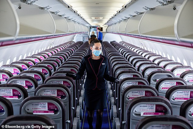 Crew checks cabin ahead of the flight on-board a passenger aircraft operated by Wizz Air