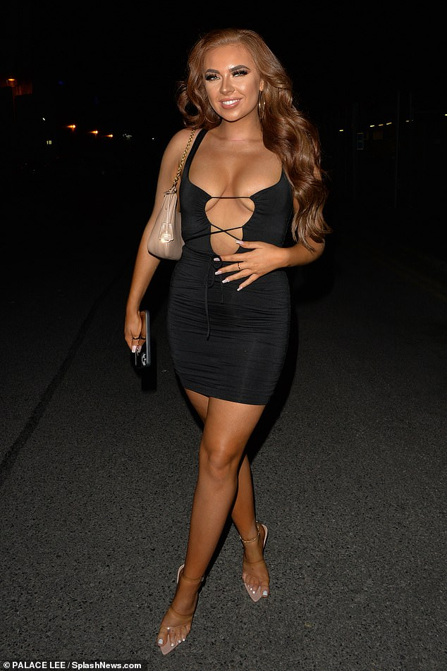 Racy:The reality star, 22, who now has a scar on her neck following the operation, showcased her pert assets in a plunging cut-out mini dress