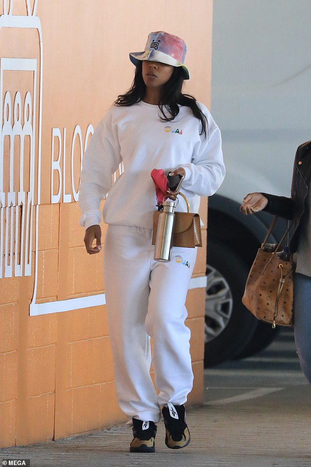 Footwear: The former Destiny's Child star, 40, opted for comfortable yet stylish Reebok trainers as she strolled down the Los Angeles street with a pal before entering a retail store