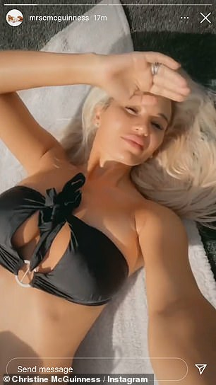 Stunning:The garment highlighted Christine's washboard abs as she filmed herself lying out in her back garden while enjoying the British heatwave
