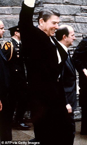 President Ronald Reagan pictured waving to a crowd before the March 30, 1981, assassination attempt at the Hilton Hotel in Washington, DC