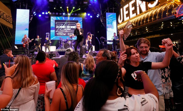 The Fremont Street Experience led the way on opening night, hosting a 'Downtown Rocks Again' event