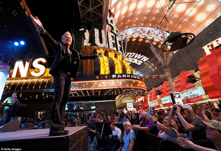 Entertainer Chris Phillips of musical act Zowie Bowie performs during a 'Downtown Rocks Again!' event