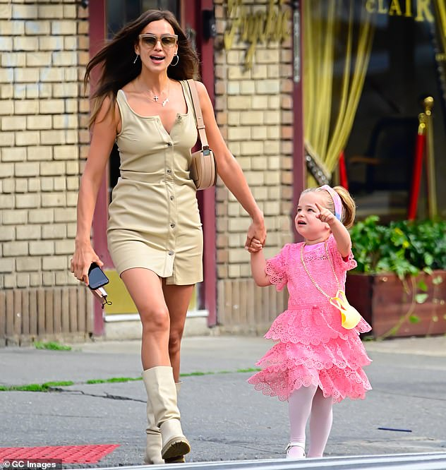 Model mom! Shayk beamed with joy as she strode across the street hand in hand with her daughter