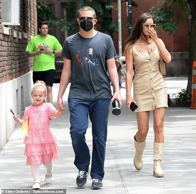 Hands on poppy! Bradley held his girl's hand as they walked side by side