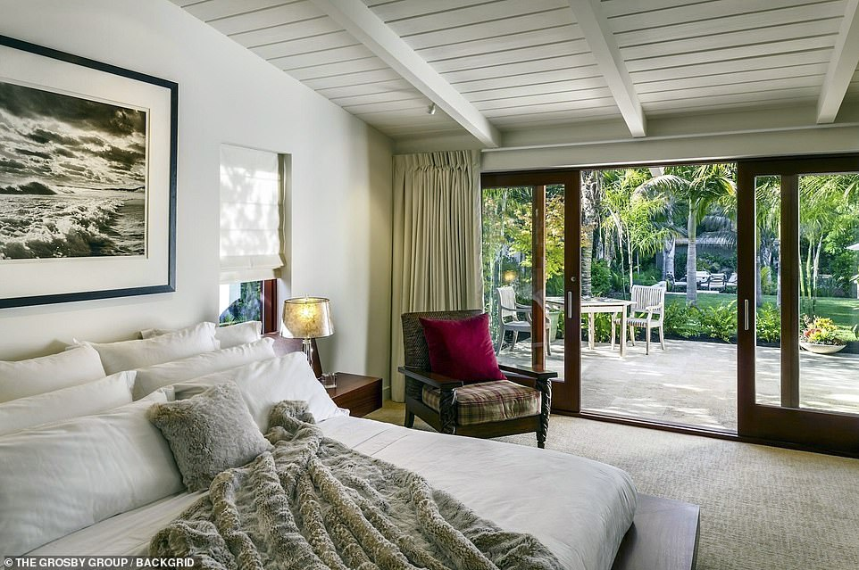 Cozy:Close by is a main bedroom with sliding glass doors that open to a roomy patio