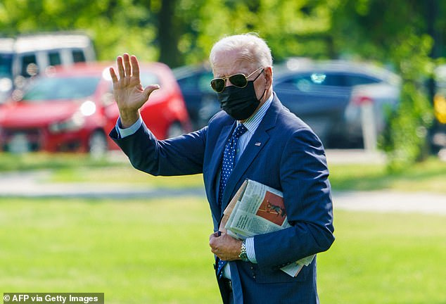 President Joe Biden waves to the cameras as he leaves for Rehoboth Beach Wednesday afternoon, taking a mid-week break to celebrate Dr. Jill Biden's 70th birthday